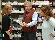 (L) Michelle Baytarian, PA-C, MMSc, Liver Clinic Coordinator, Lead Hepatitis C Clinician, Lead Physician Assistant, discusses the latest medication in the VA Boston pharmacy with Tony Houranieh, RPh, MS, PhD, Associate Chief of Pharmacy, Clinical Services Co-Chair, VA Boston IRB and Rayhme Collins,