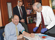 From left: Bob McDonald, Secretary, Dept. of Veterans Affairs; John Concato, MVP Principal Investigator; J. Michael Gaziano, MVP Principal Investigator