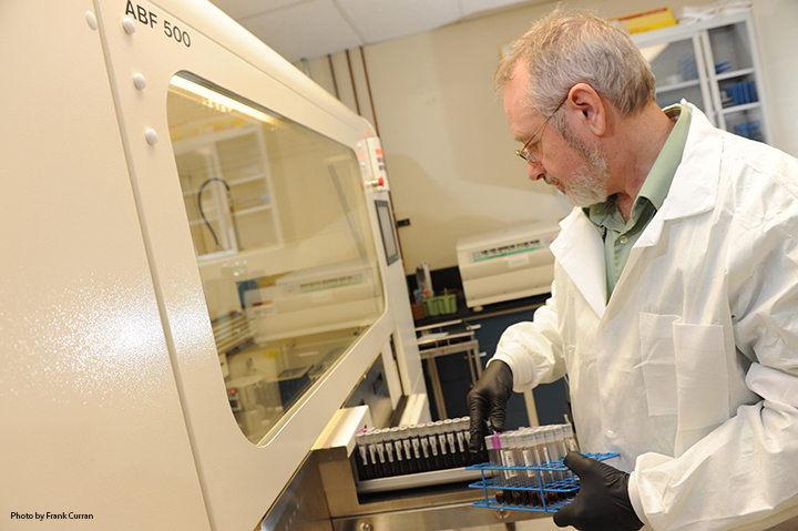 Don Humphries, Scientific Lab Director for the MVP Biorepository, processes new DNA donations from Veterans